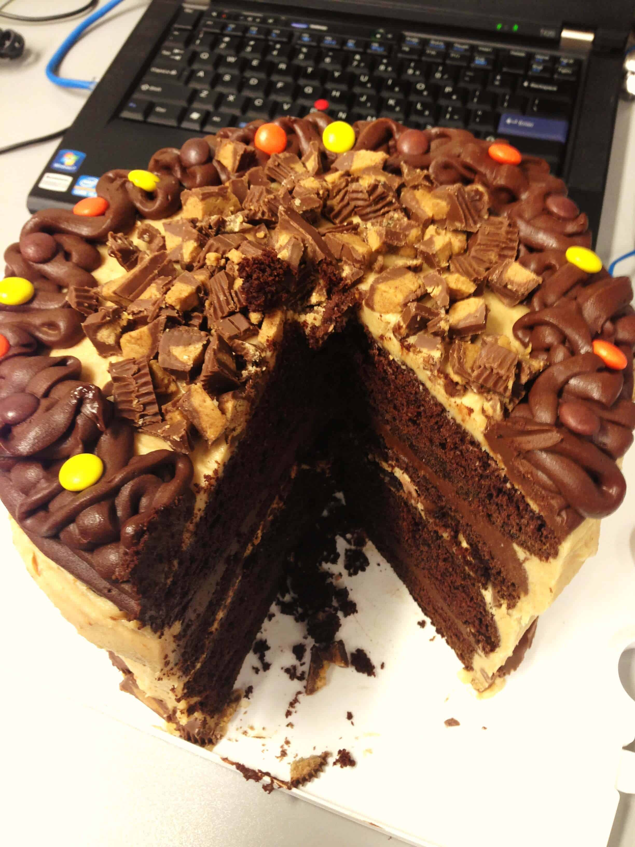 image of a reese's peanut butter cup cake that's been sliced into