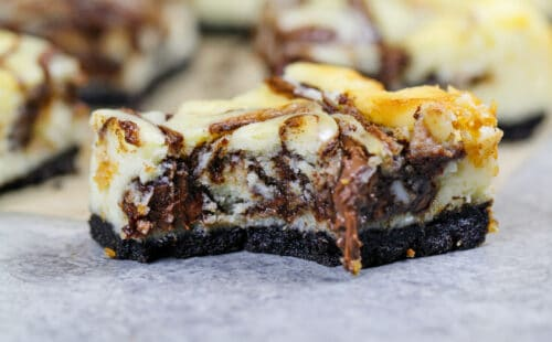 image of nutella cheesecake bars with an oreo crust