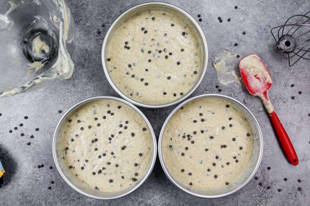image of chocolate chip banana cake layers in an 8-inch pan ready to be baked