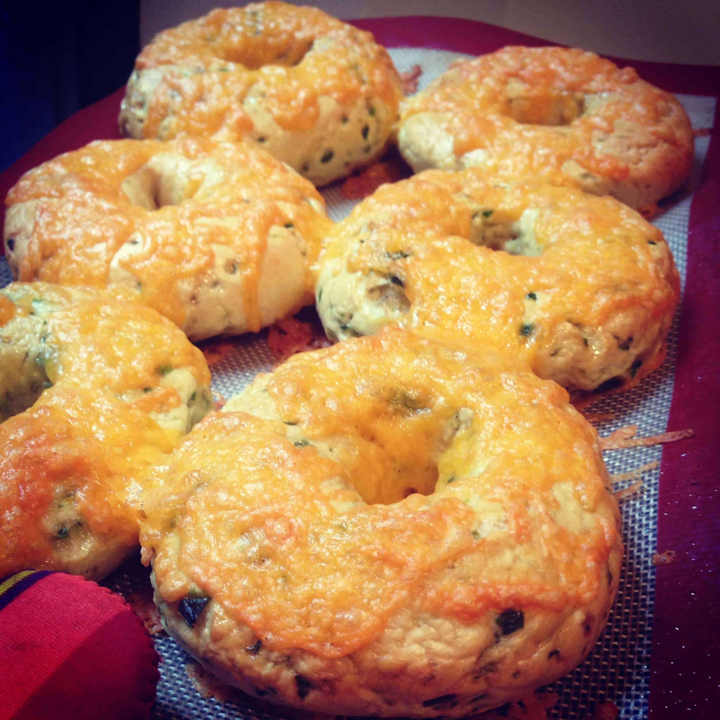 photo of cheddar jalapeno bagels being pulled out of the oven