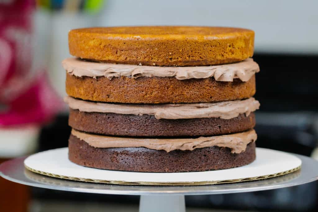 image of ombre chocolate cake layers stacked and ready to be crumb coated