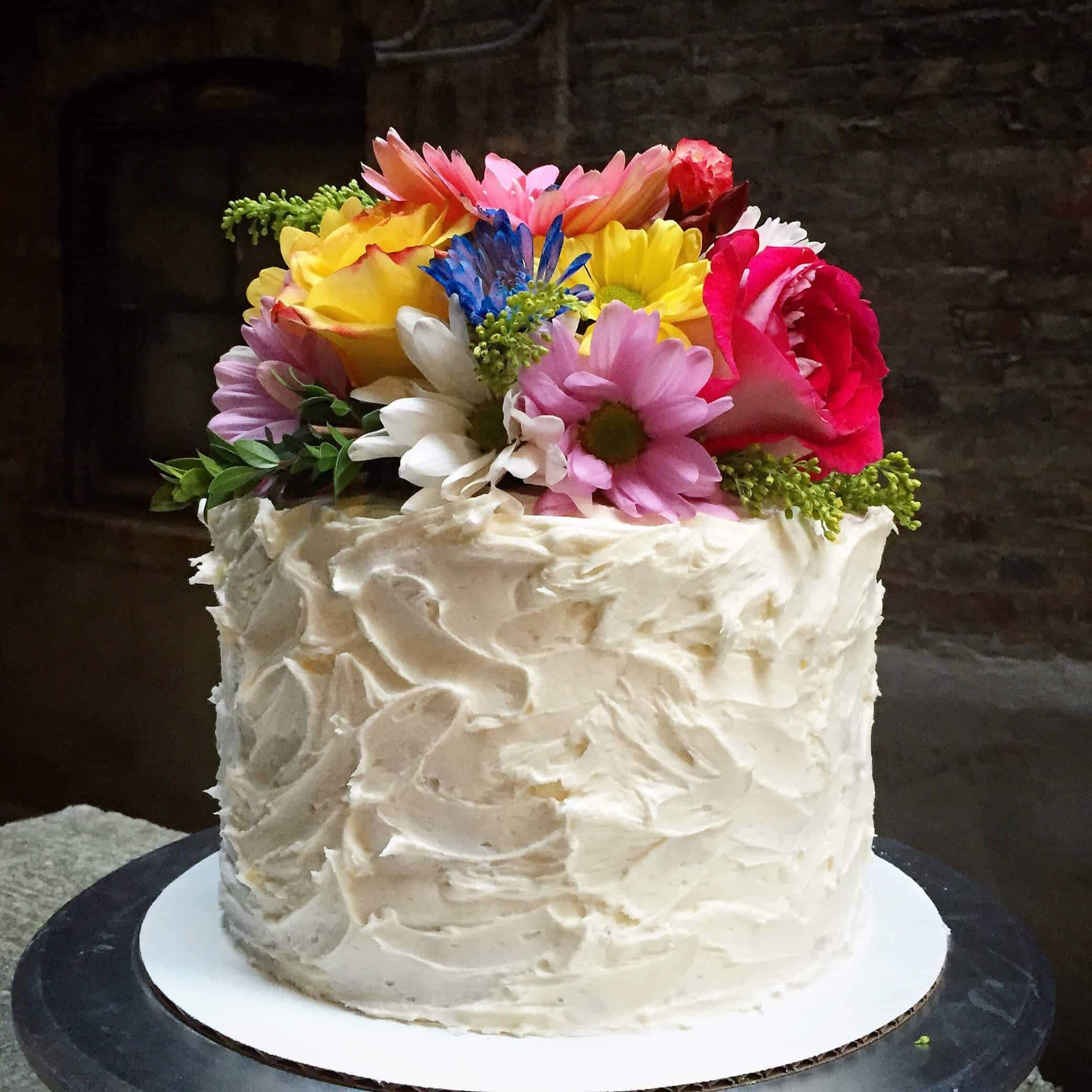 Rose water cake decorated with organic fresh flowers