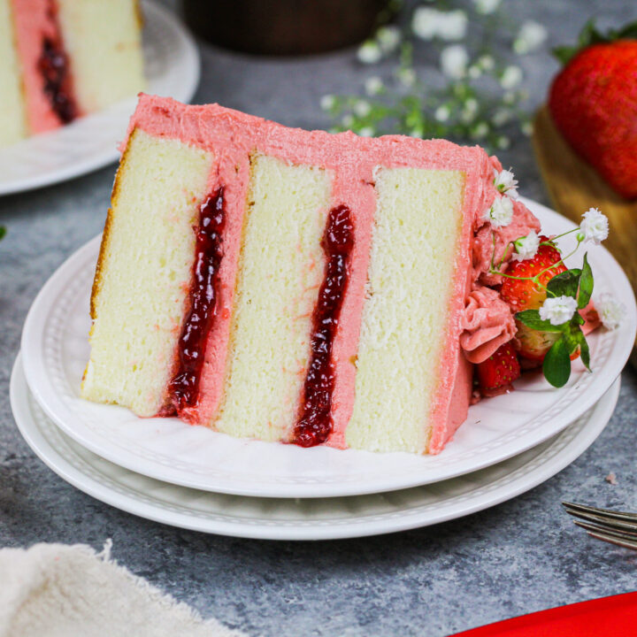 image of a vanilla layer cake recipe frosted with strawberry american buttercream