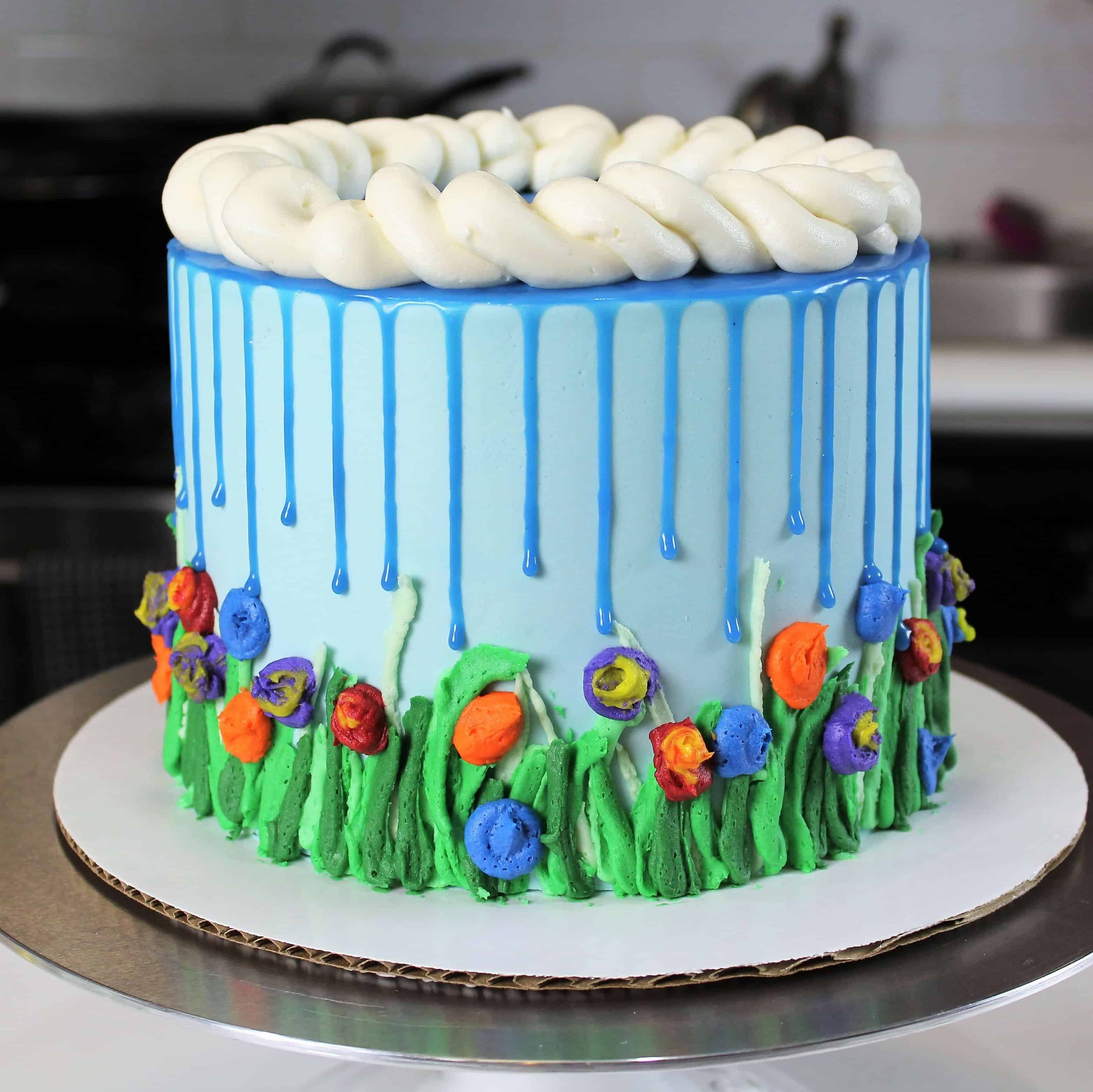 April showers cake with blue drips to look like rain