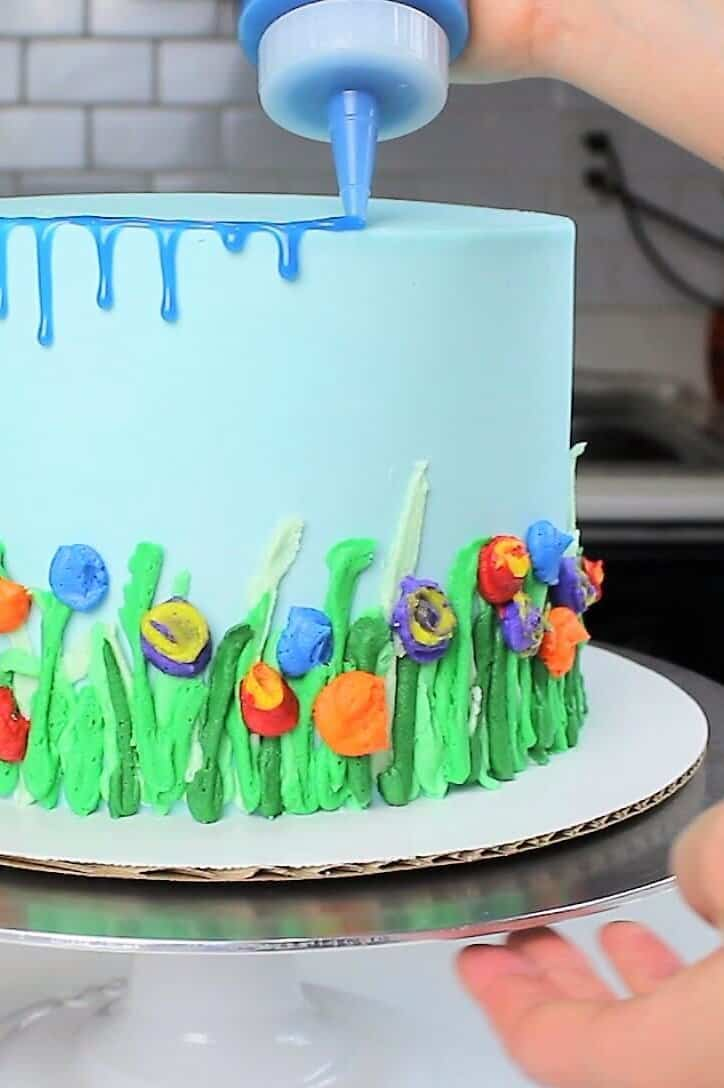 adding drips onto my Spring themed cake