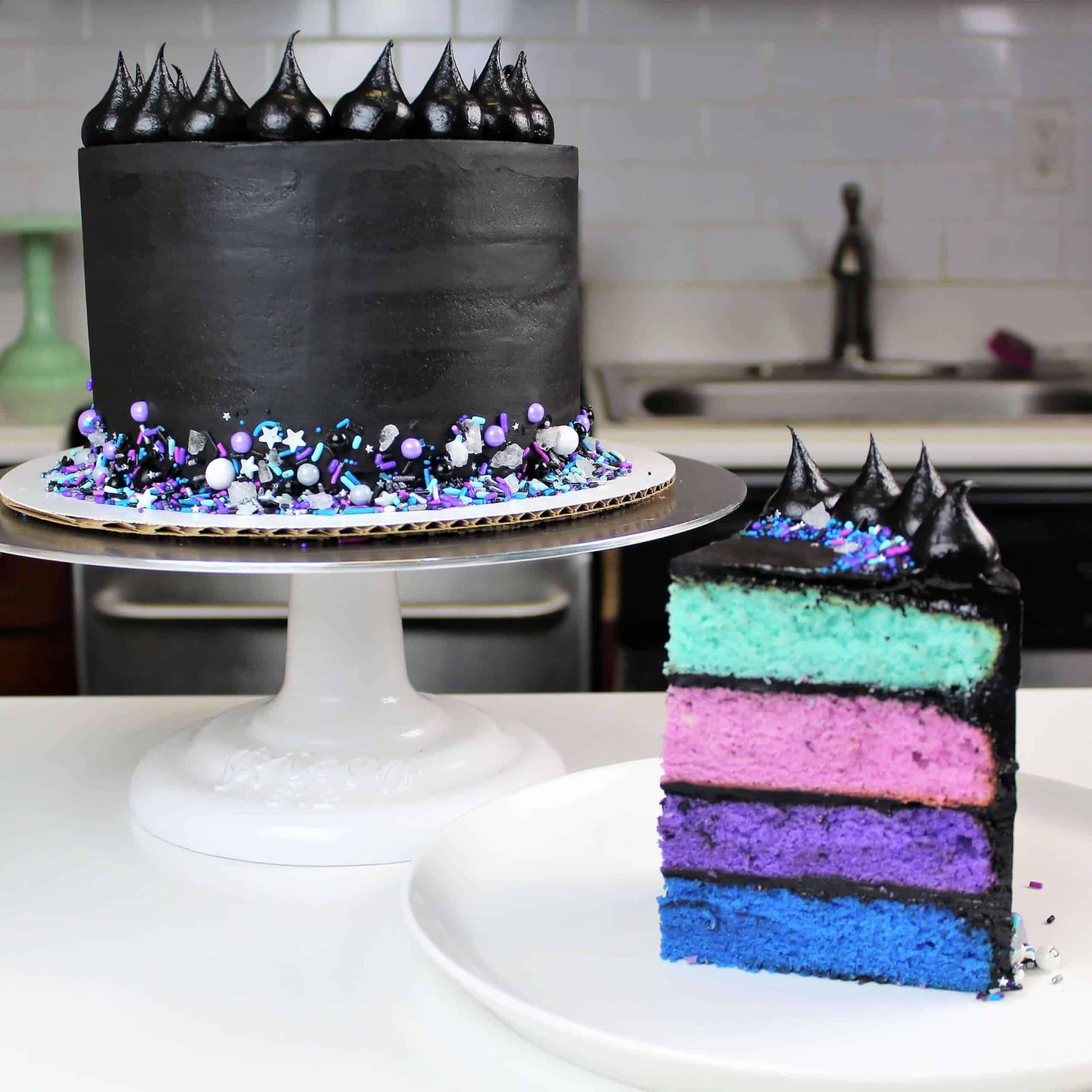 Galaxy themed cake frosted with black buttercream