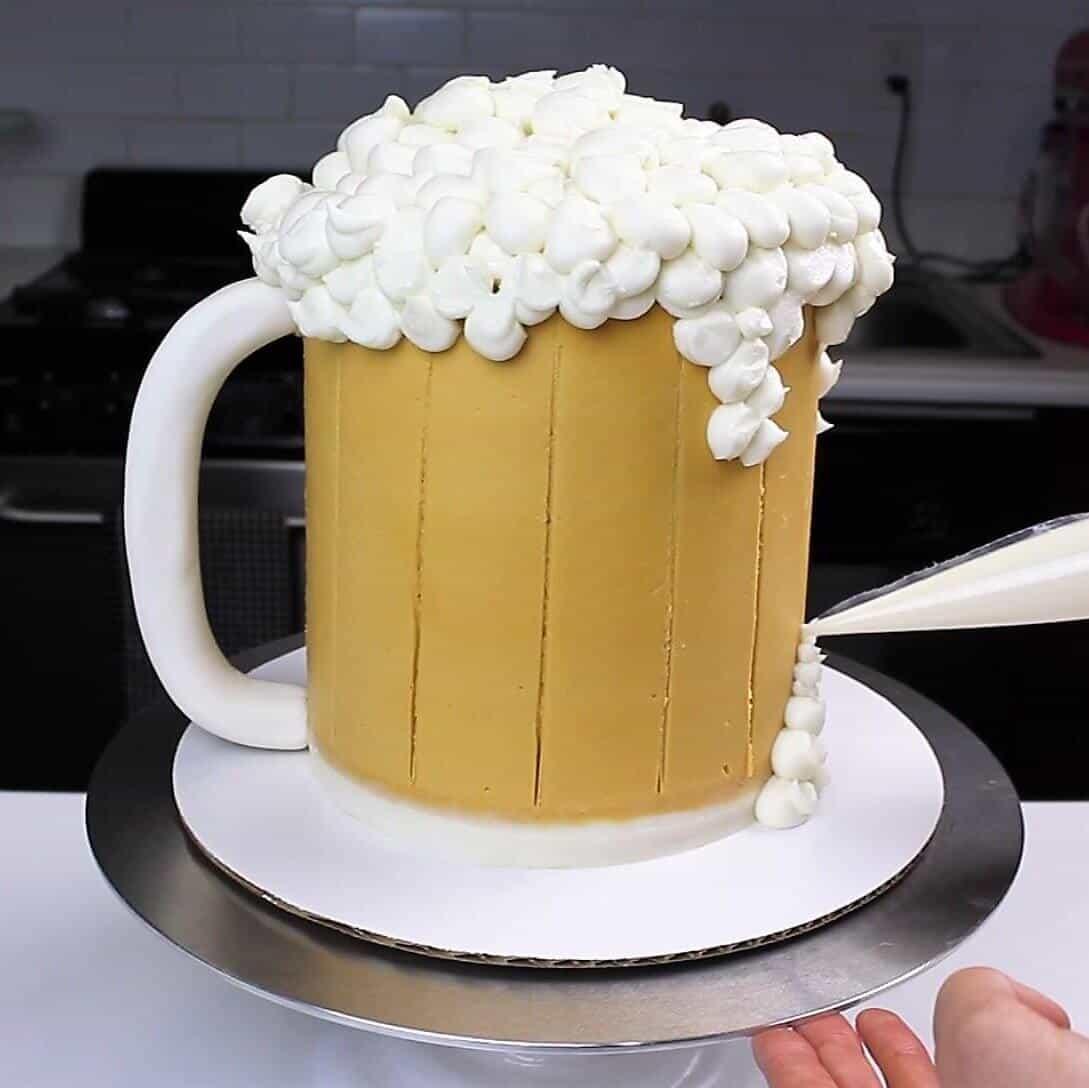 Piping bubbles onto my beer mug cake