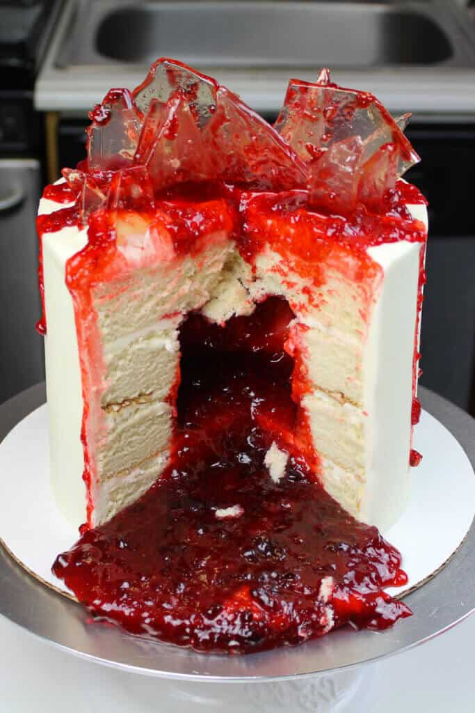 image of shattered glass cake, filled with strawberry jam to look like blood