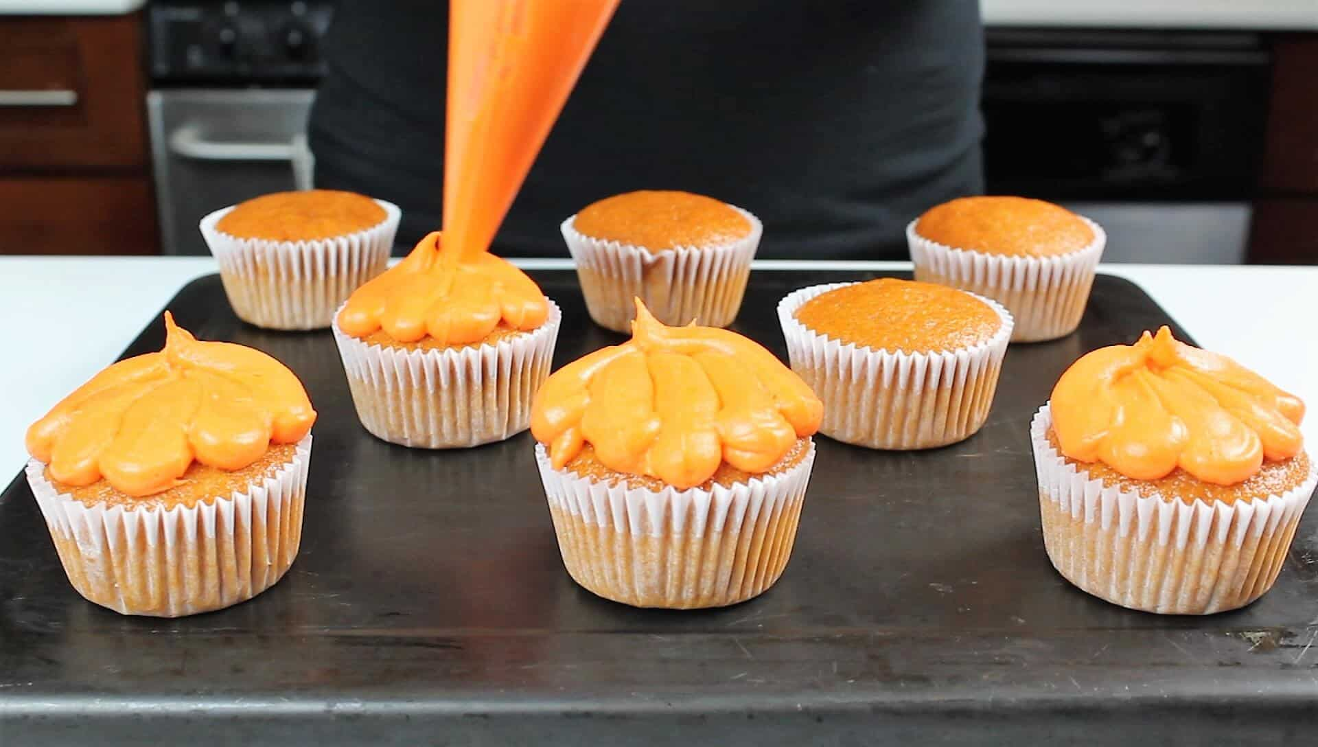 photo of pumpkin cupcakes frosted with orange cream cheese frosting