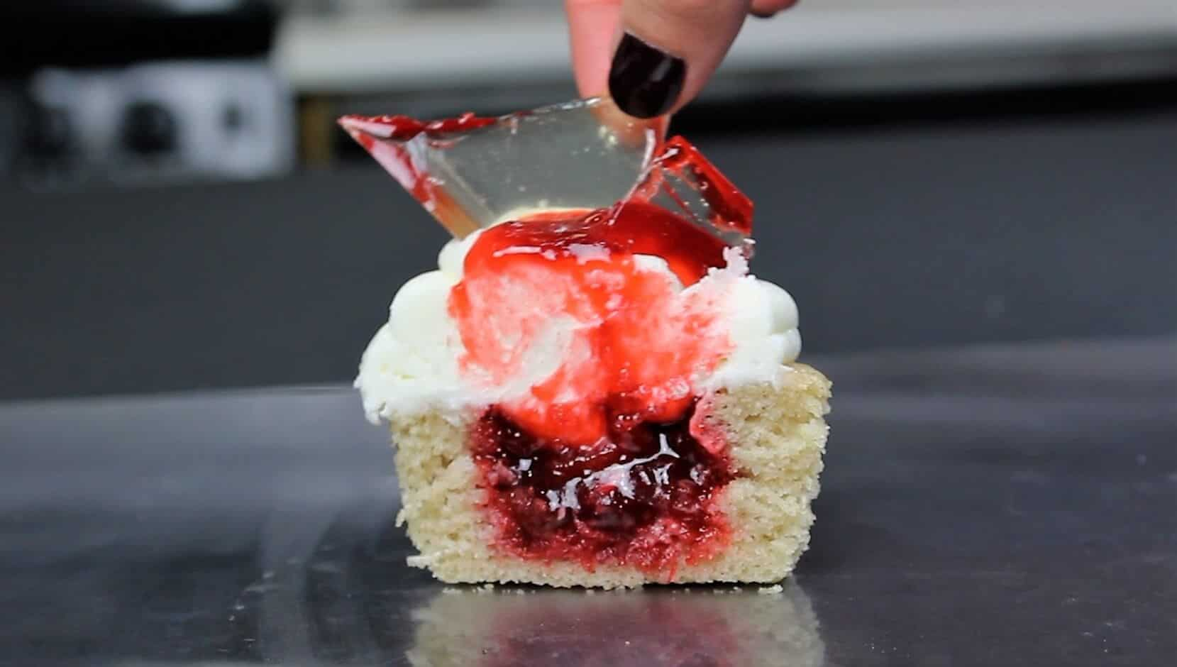 photo of cut open shattered glass cupcake, filled with strawberry jam