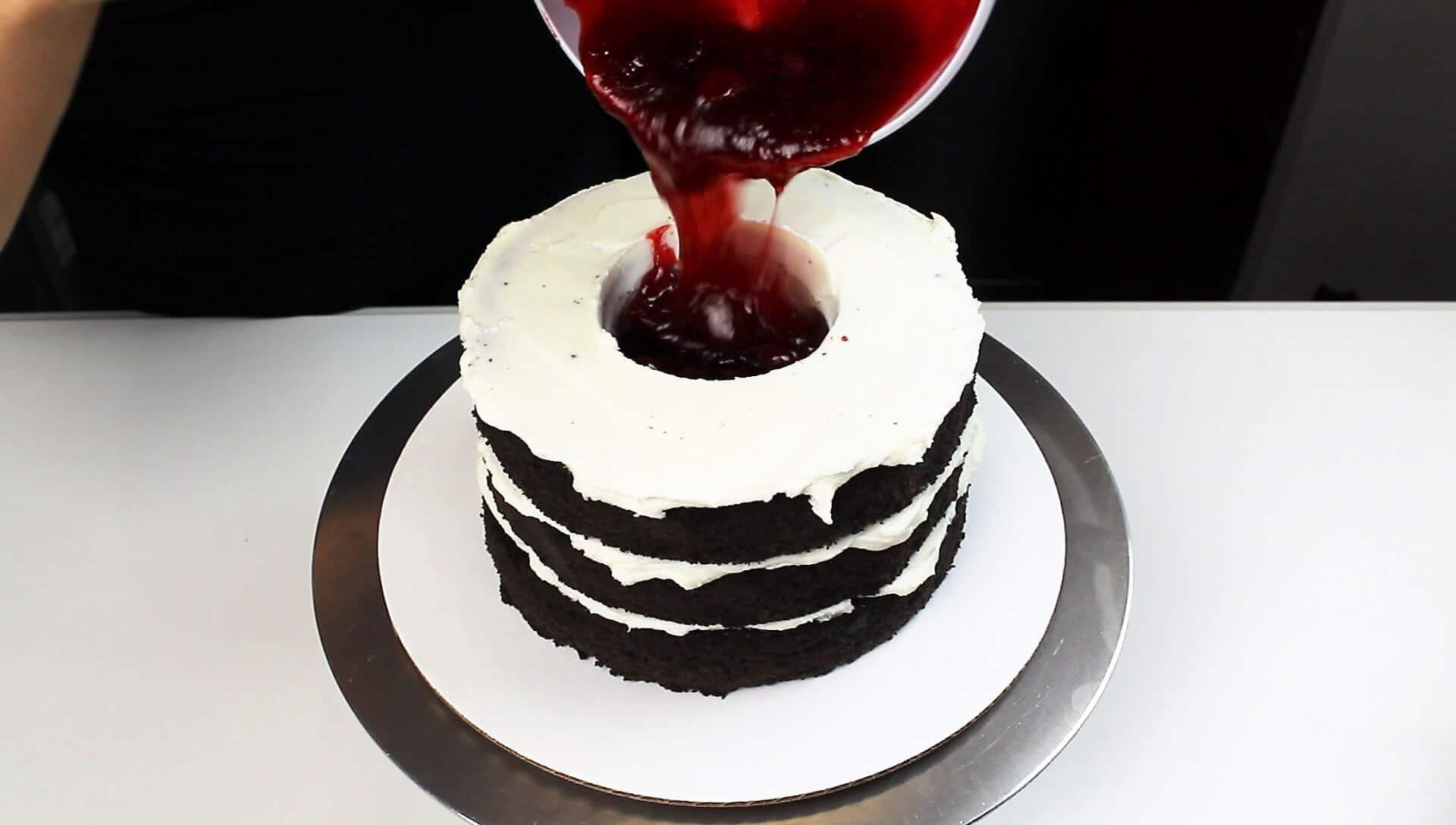 photo of adding strawberry jam into my vampire bat cake