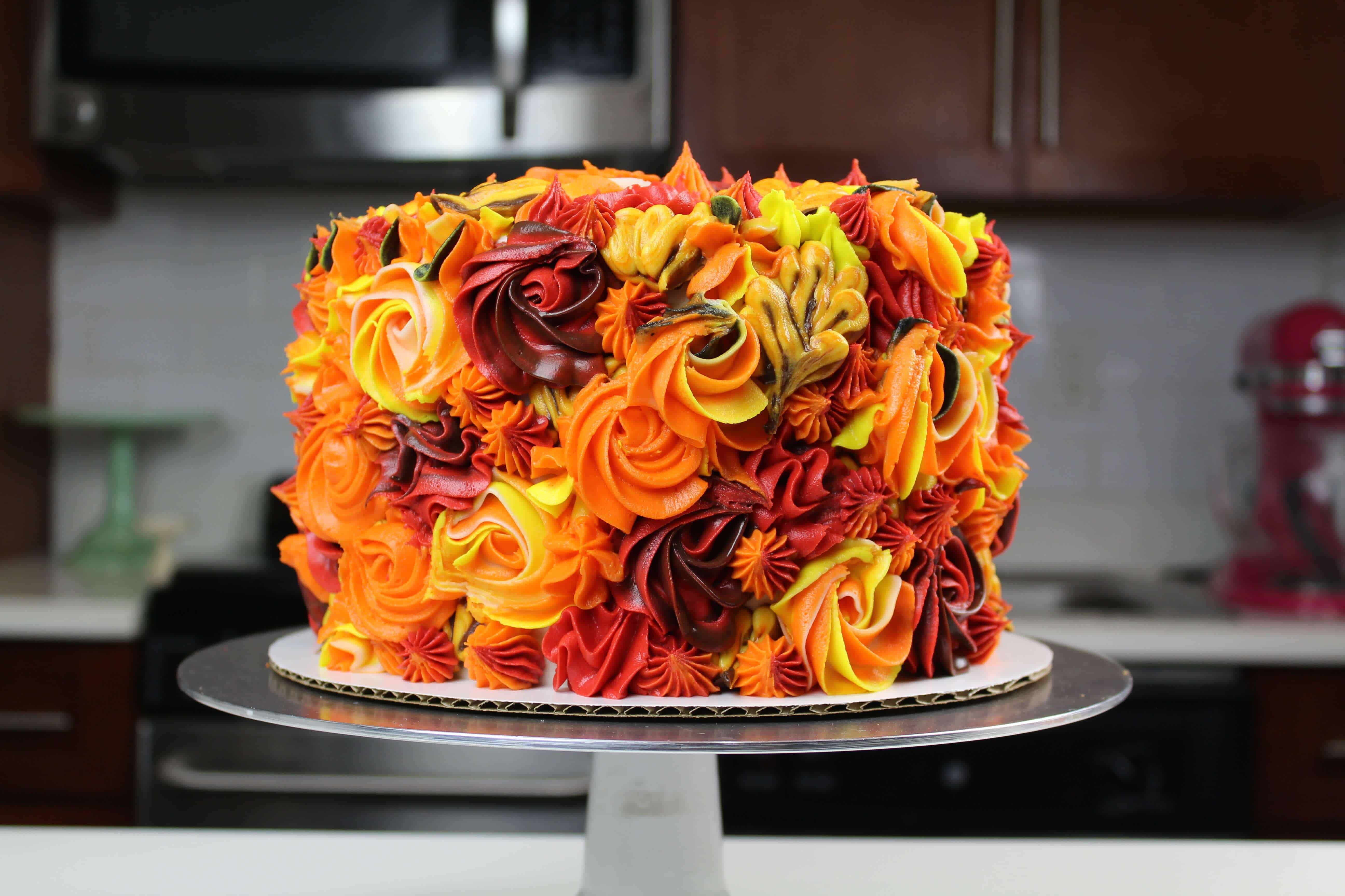 image of an apple pie layer cake that's been decorated with pretty Fall buttercream