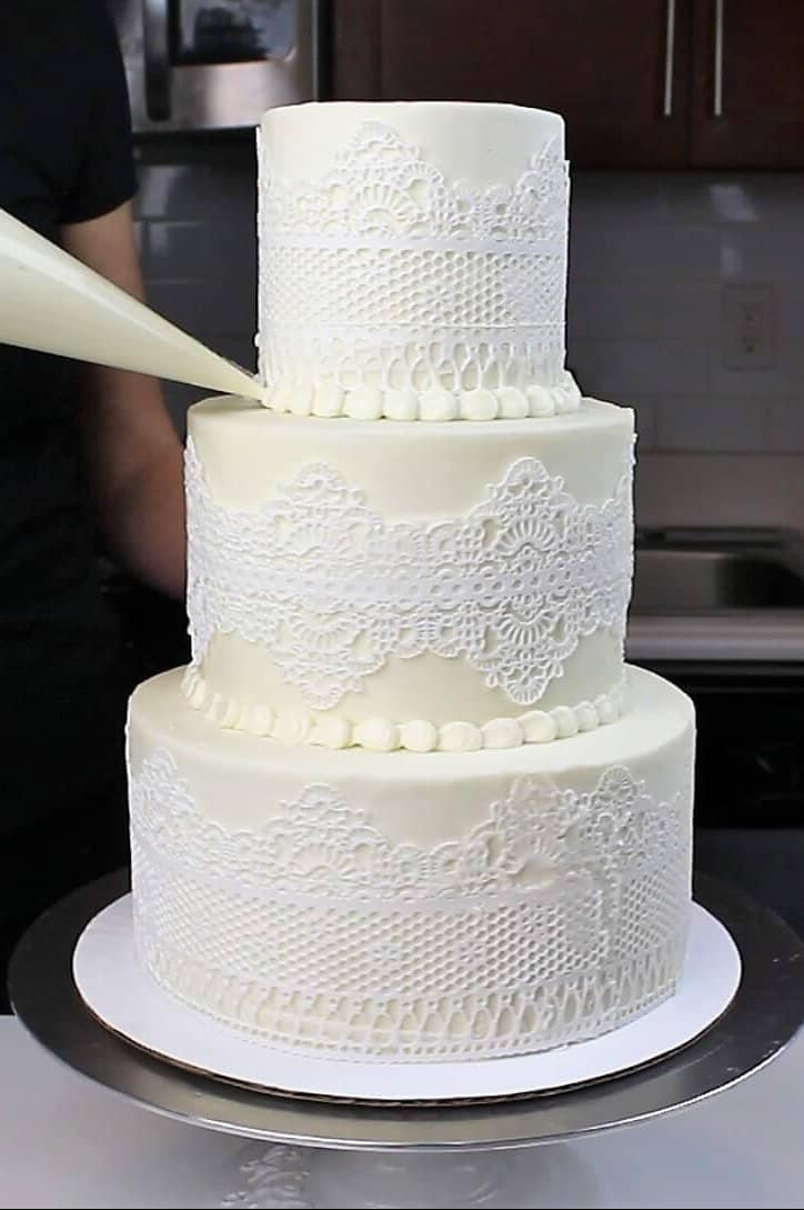 Image of 3 tiered wedding cake with edible lace