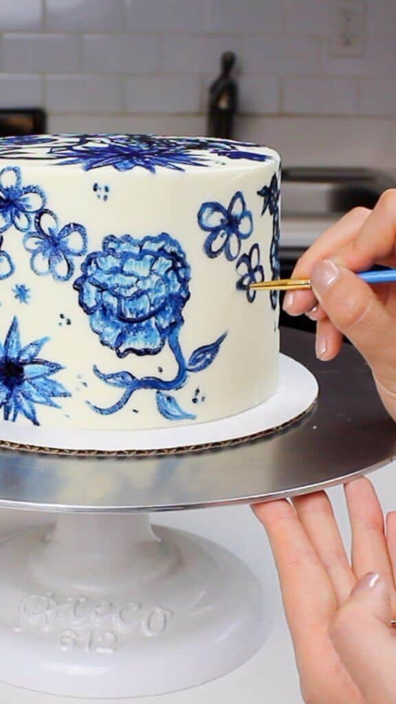 Image of cake being painted with gel food coloring