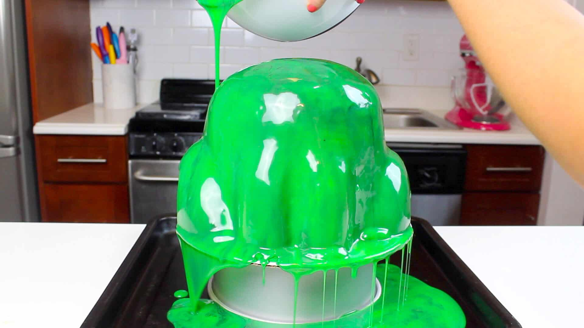 pouring glaze over frog cake #2