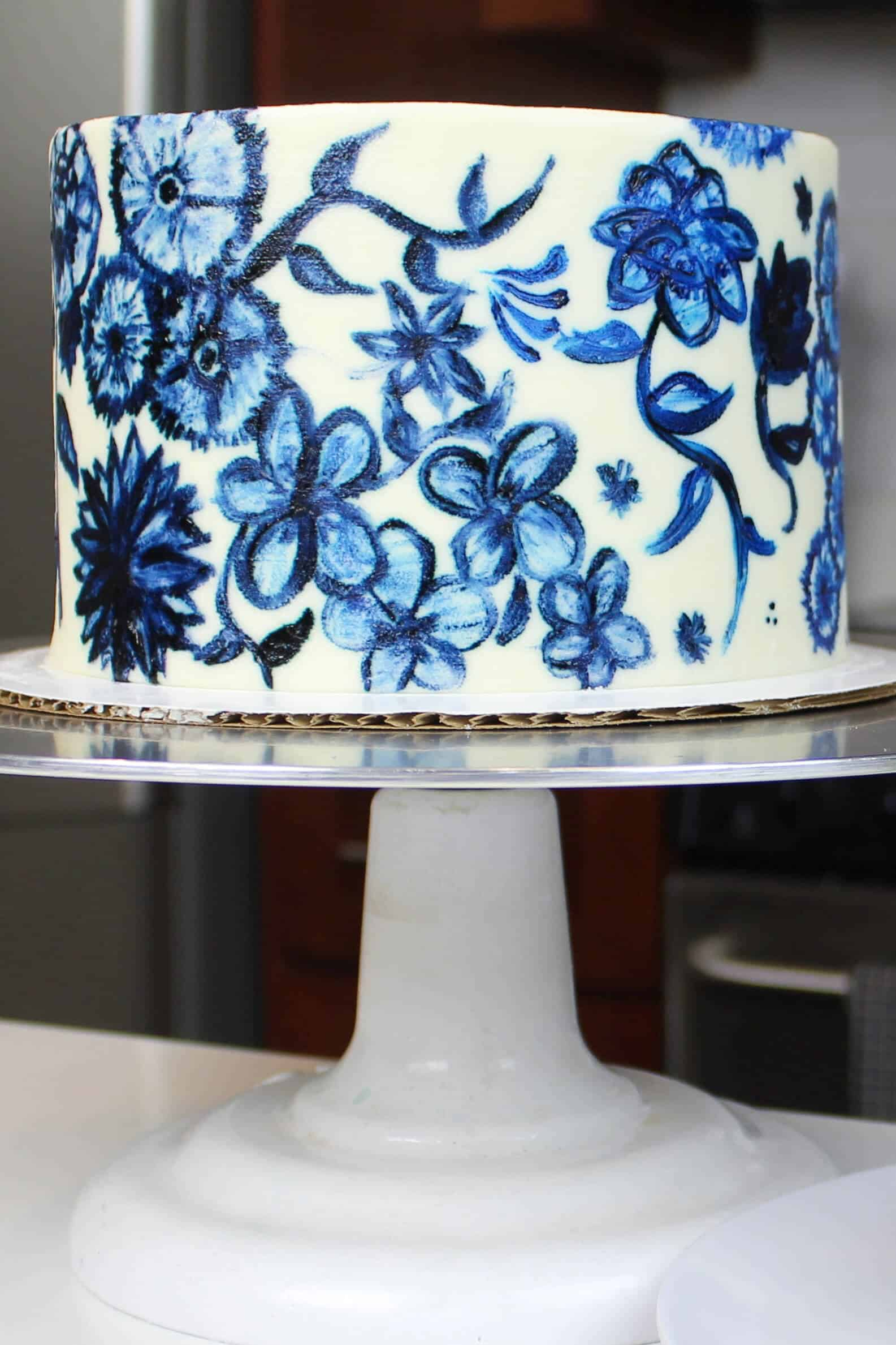 beautifully painted blue floral cake, made with 6 inch vanilla cake layers
