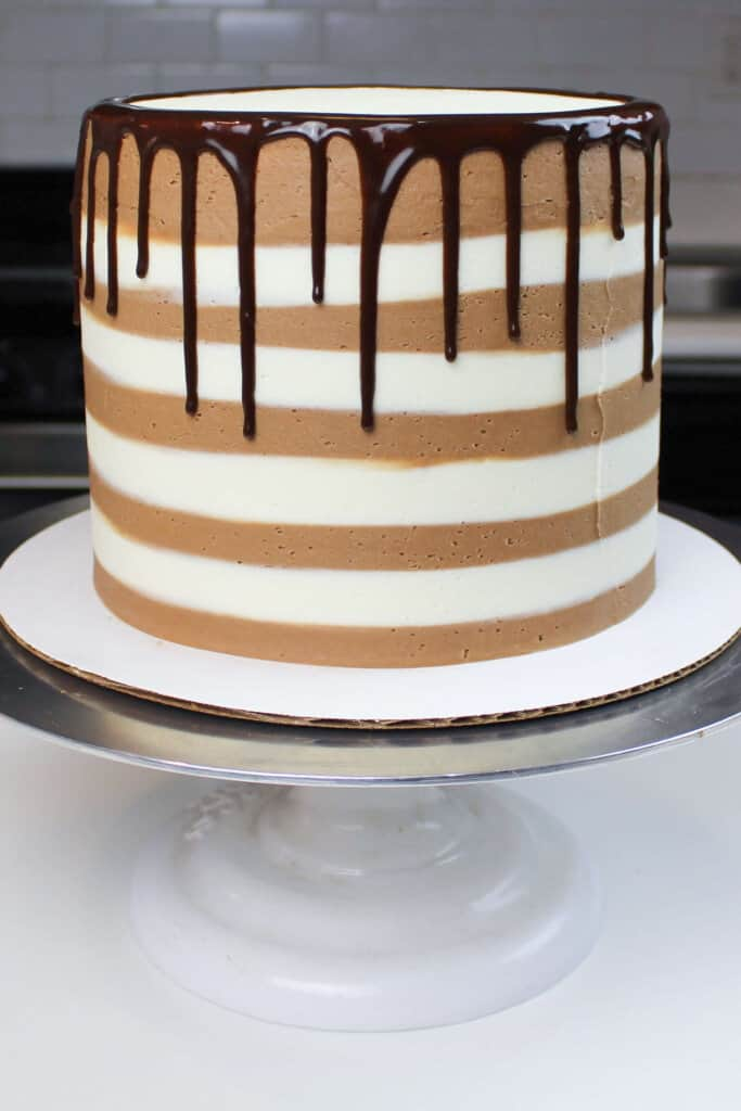 chocolate drips on striped smores cake