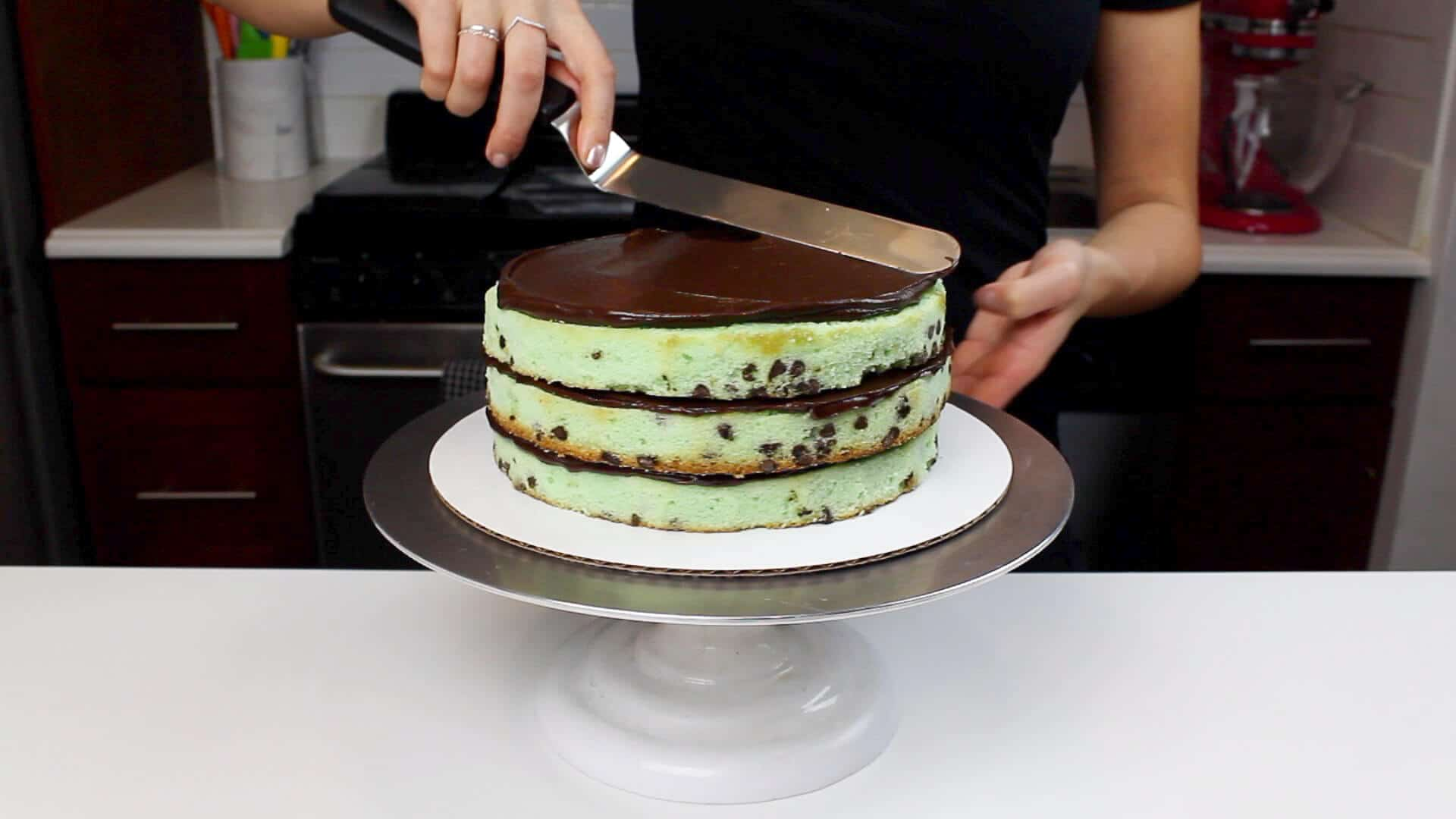 spreading ganache onto layers