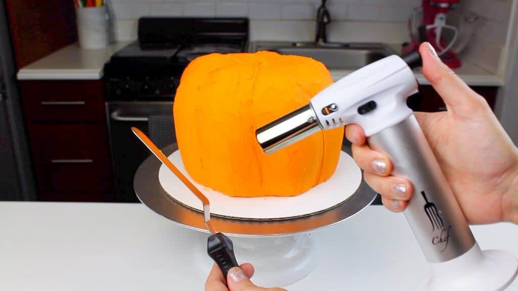 image of heating up an offset spatula with a kitchen torch