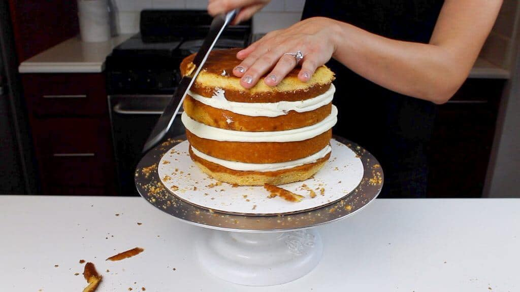 image of trimming pumpkin spice cake layers