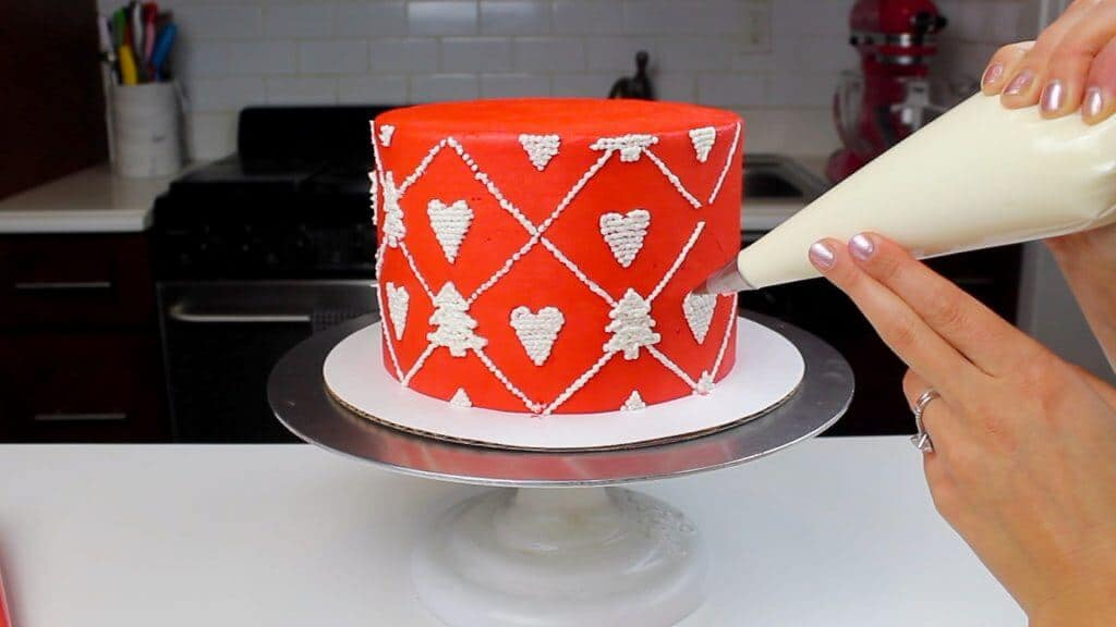 image of knitted sweater cake being piped with buttercream