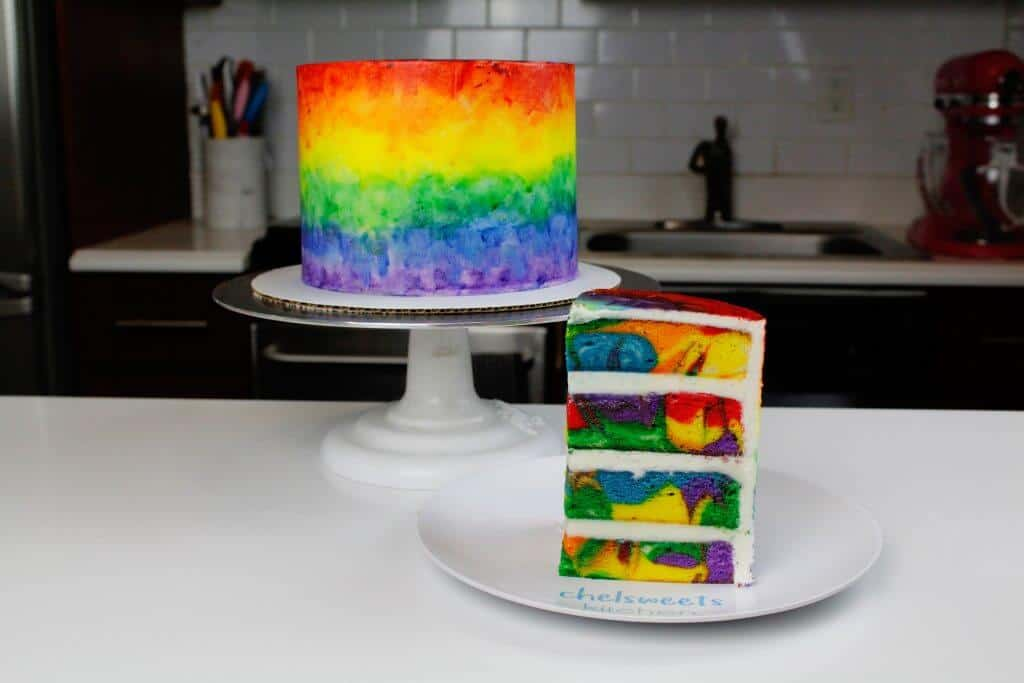 Swirled and marbled rainbow cake layers