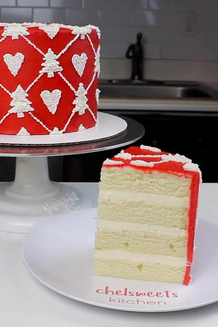 Image of my christmas sweater cake, decorated with bright red buttercream