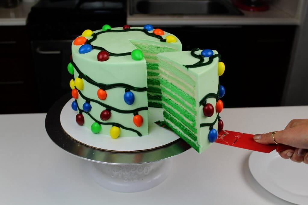 image of easy christmas tree lights cake made with M&Ms