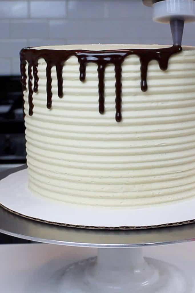 Easy drip method - Adding ganache drips onto a cake using a plastic squirt bottle