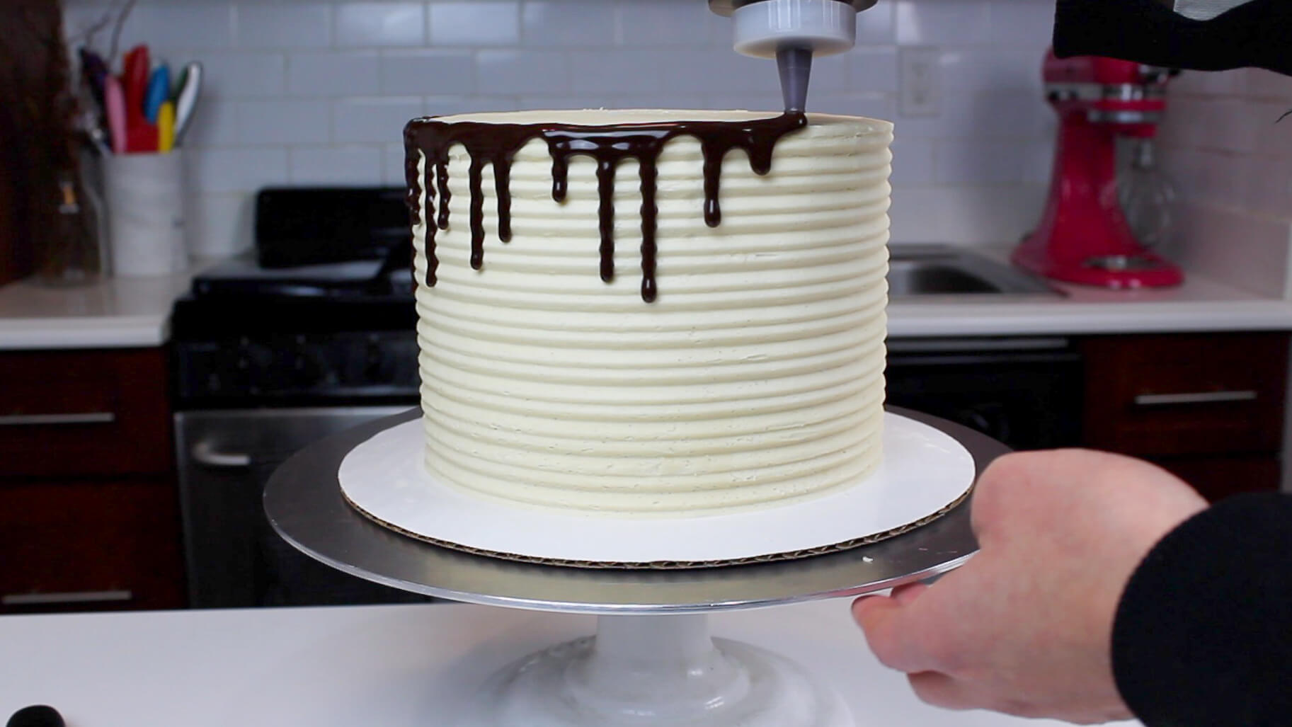 adding drips to cake