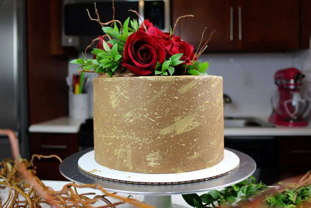 chocolate engagement cake decorated with edible gold and fresh roses photo