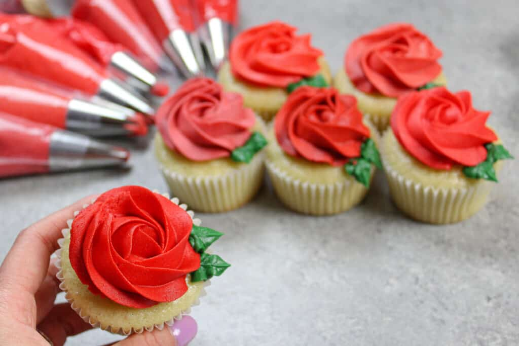 image of cupcake decorated with a bright red buttercream rosette