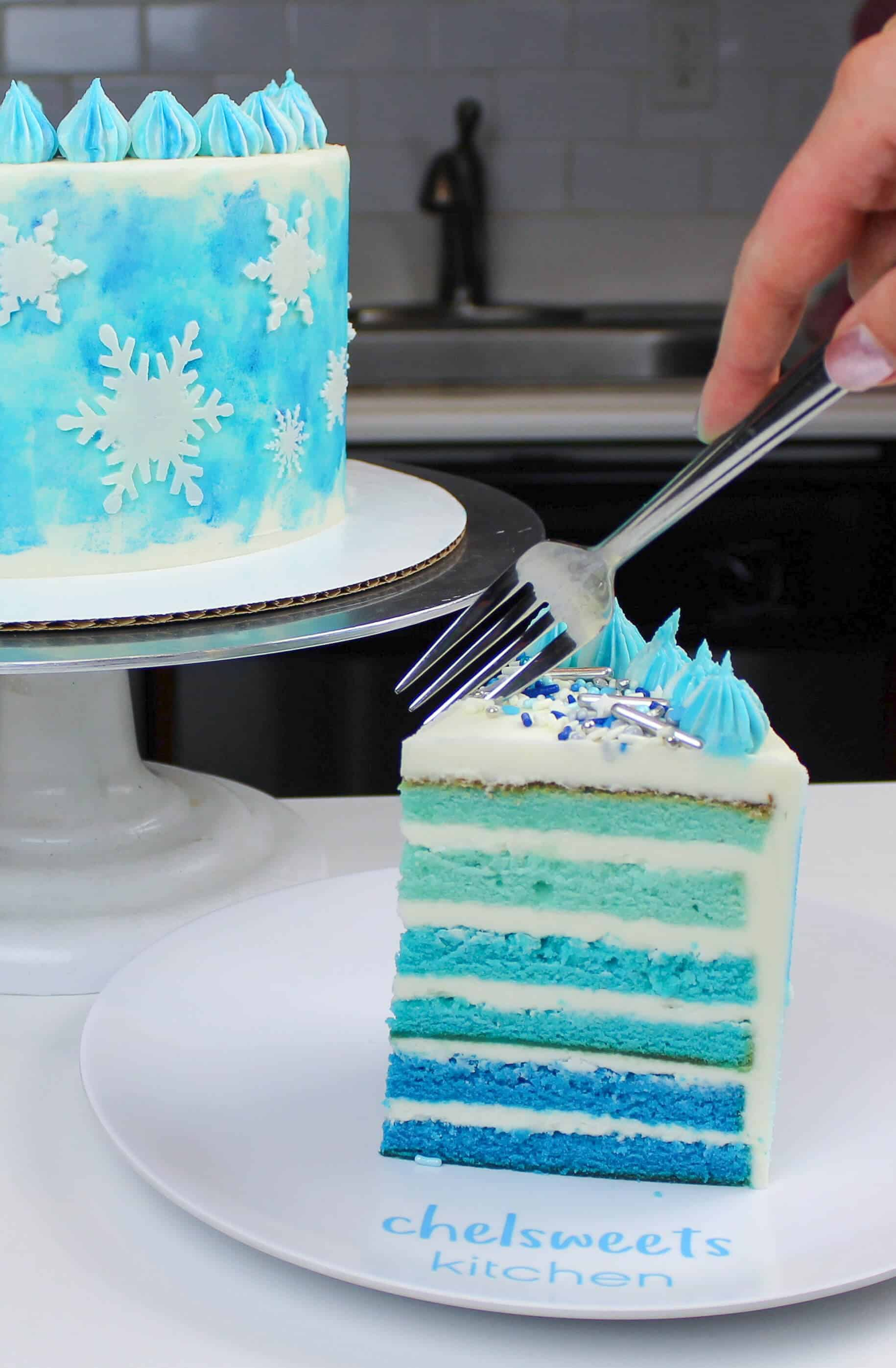 The perfect winter cake! An ombre blue cake decorated with buttercream snowflakes