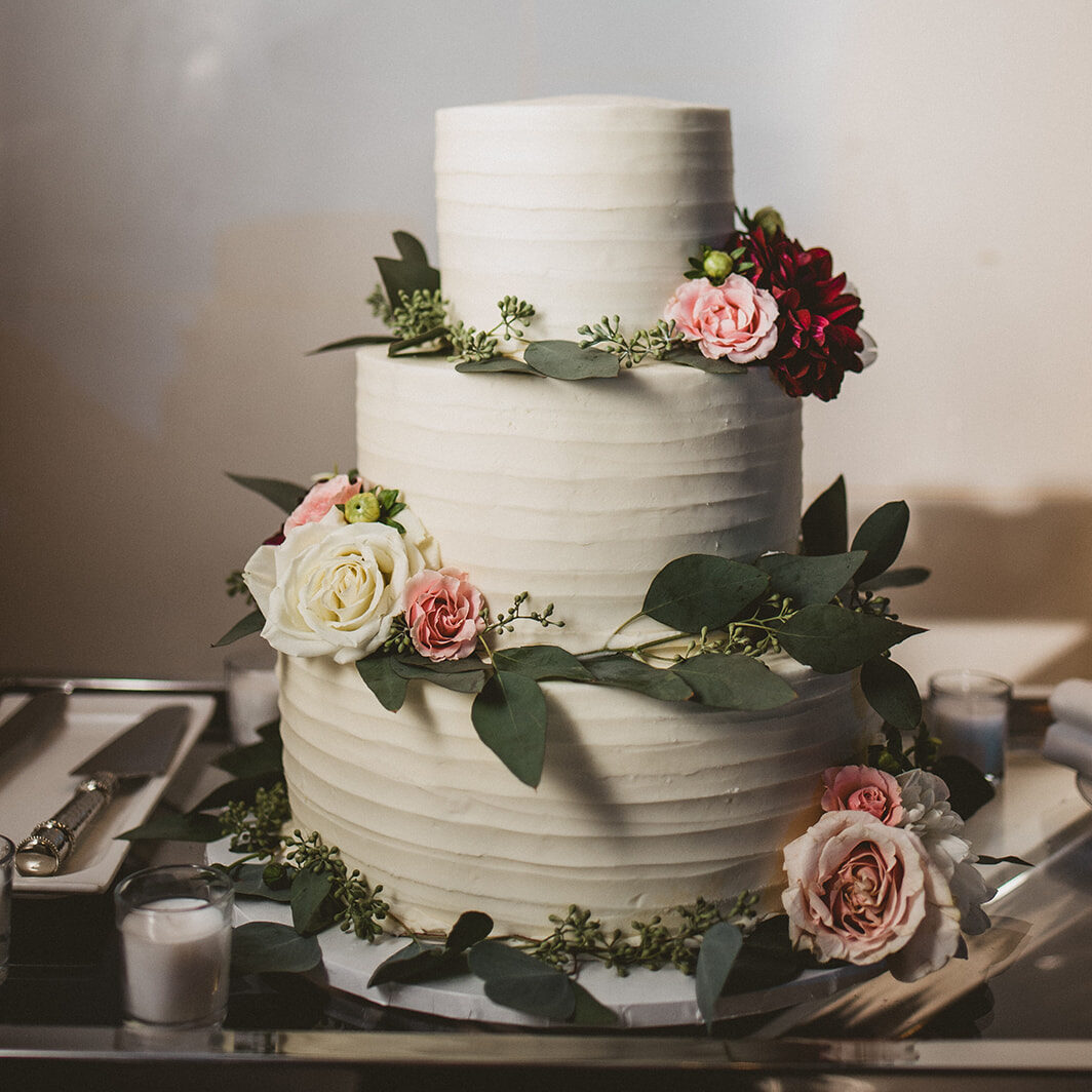 image of a wedding cake sized out using a cake portion guide to determine how many servings and what size of cake needed to be made