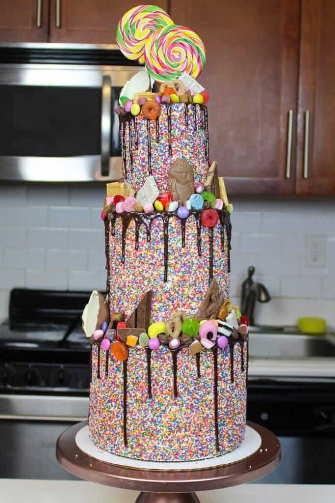 Photo of a three tiered candy drip cake