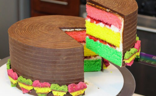 closeup of sliced Italian rainbow cookie cake