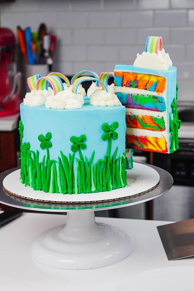 image of a rainbow st. patrick's day cake with four leaf clovers