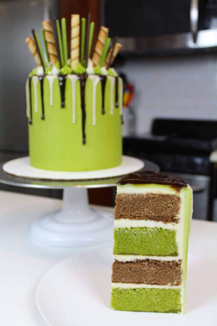 Sliced matcha cake decorate with a chocolate drip