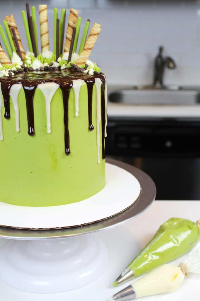 decorated matcha and chocolate layer cake, with chocolate drips