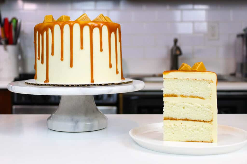 sliced caramel drip cake photo
