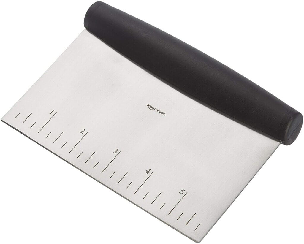 photo of bench scraper, a tool used to smooth frosting in cake decorating