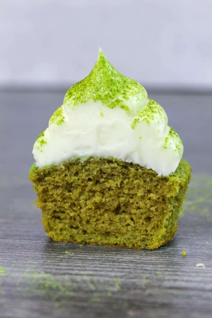 cut open matcha cupcake, showing how fluffy and wonderful the texture is