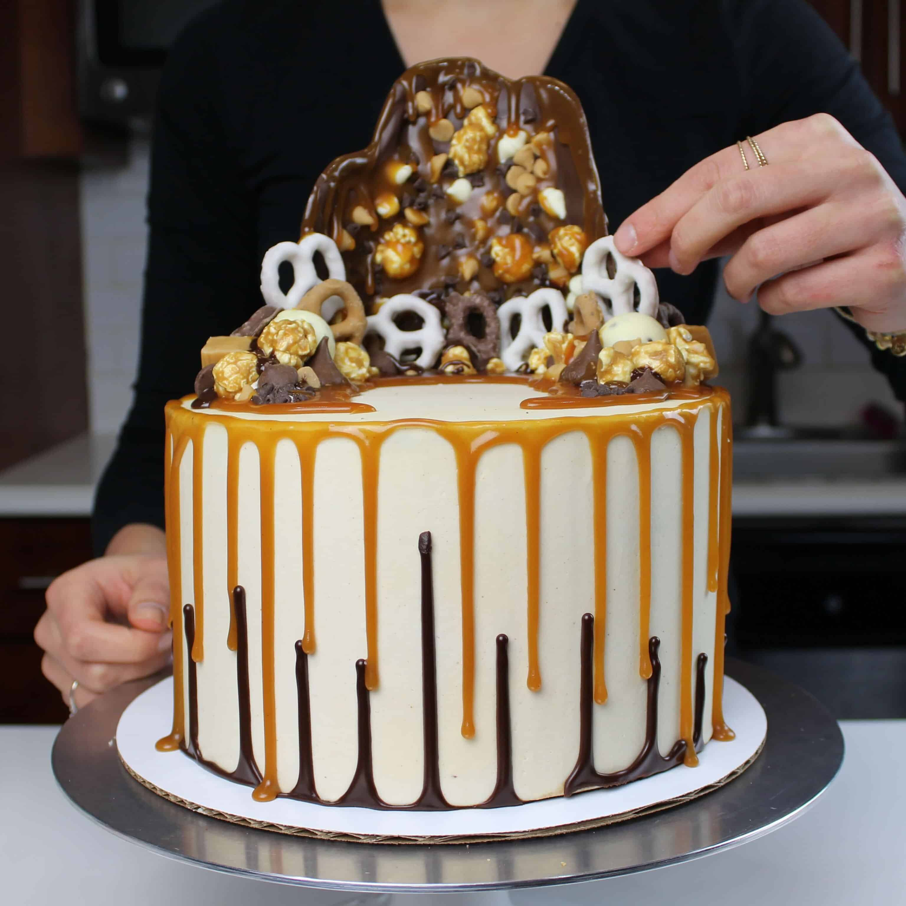 image of cake with double drip, made with chocolate ganache drips and caramel drips