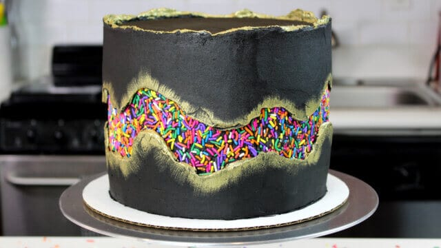 photo of funfetti cake decorated with a sprinkle fault line