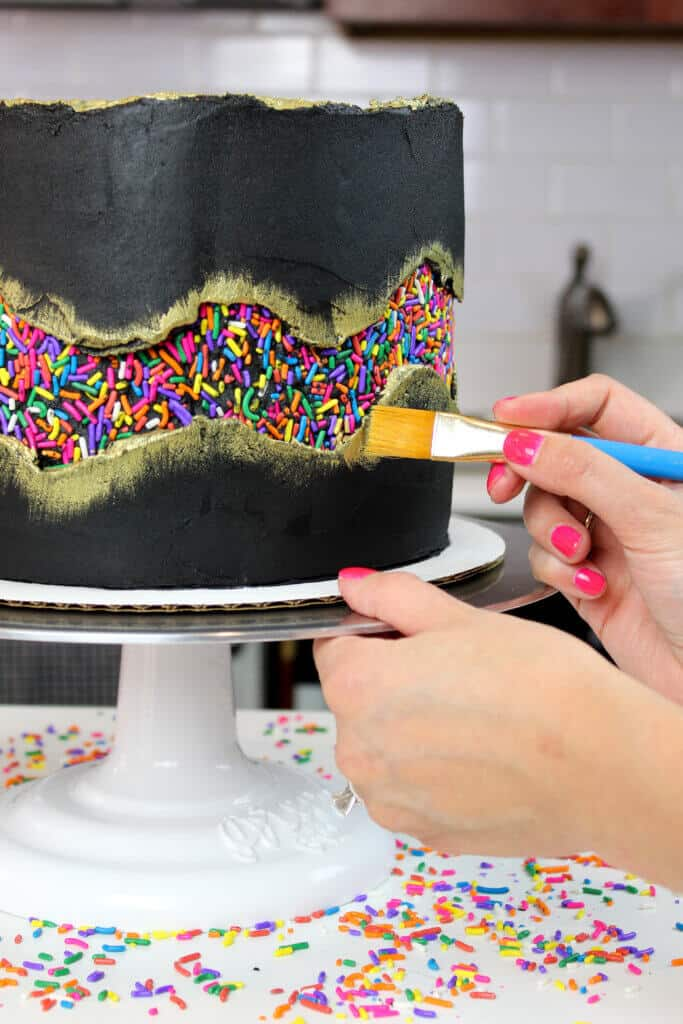 Painting gold onto my sprinkle funfetti cake photo