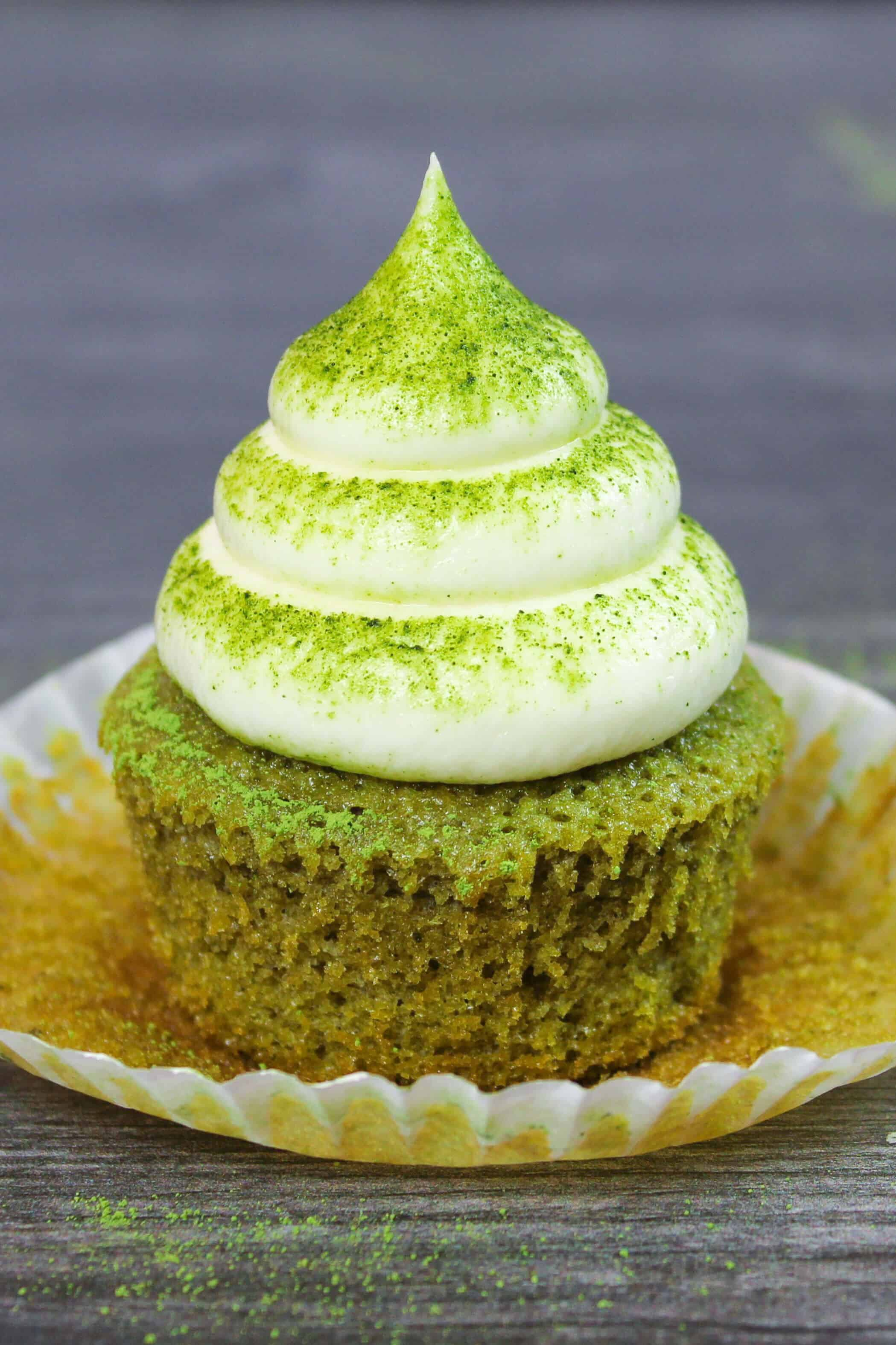 matcha cupcake, frosted with vanilla buttercream and dusted with matcha powder