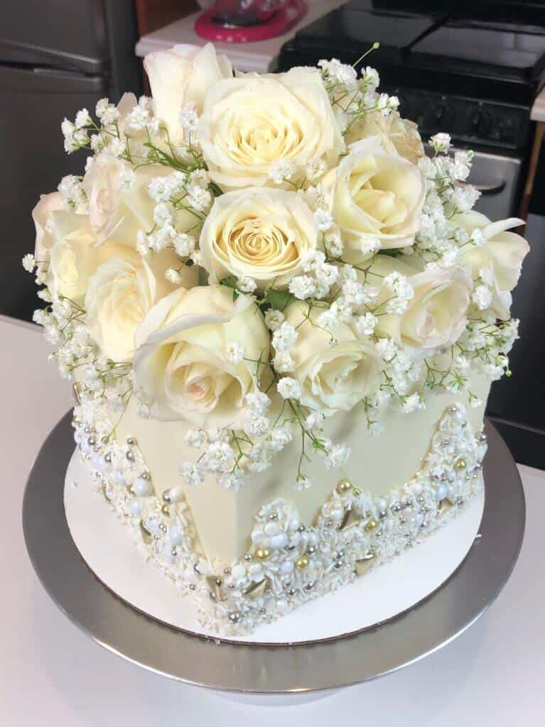 white engagement cake photo decorated with roses