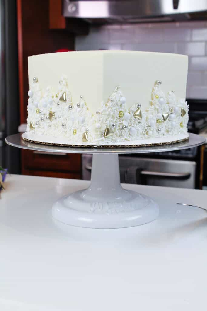 photo of square white cake decorated with a metallic sprinkle blend