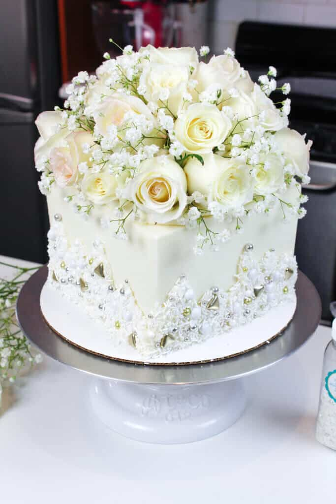 photo of square engagement cake decorated with fresh flowers