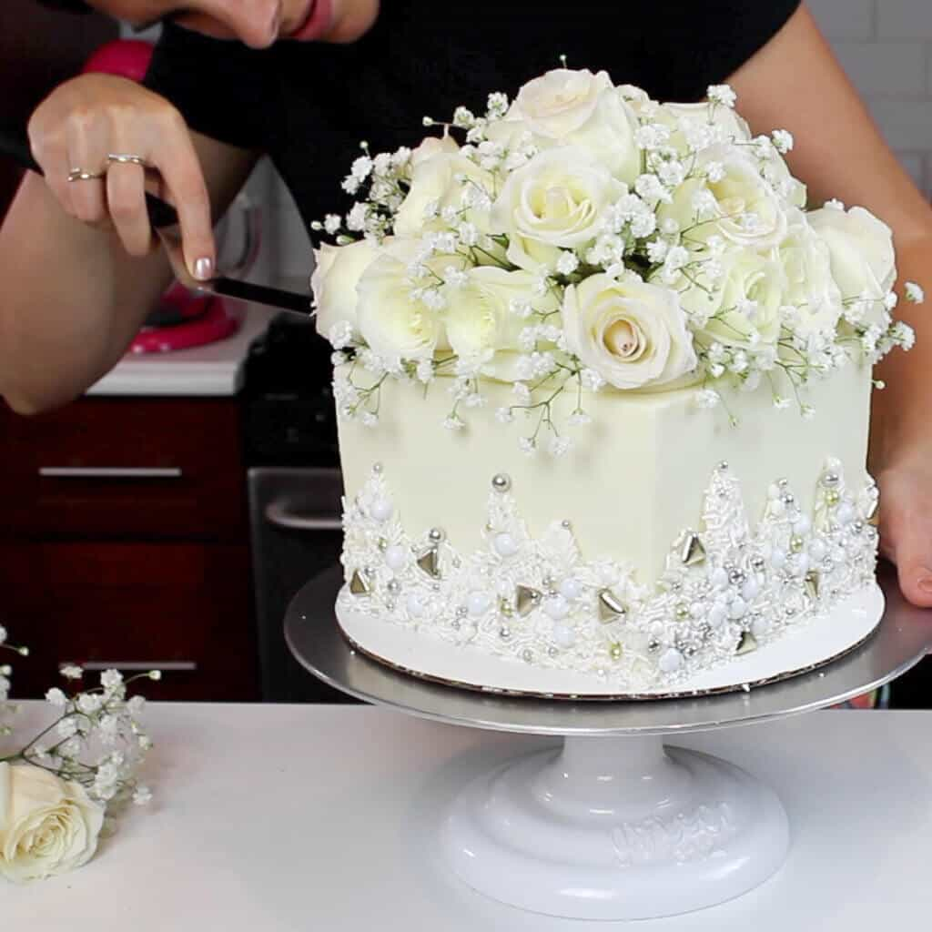 photo of easy method used to add fresh flowers on a cake